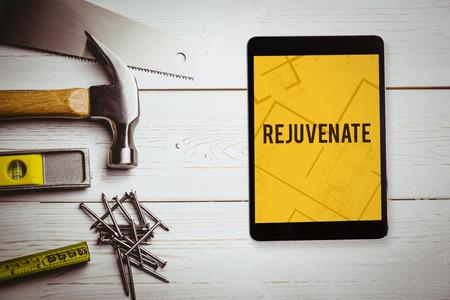 revitalize: The word rejuvenate  and tablet pc against digital tablet displaying blueprint