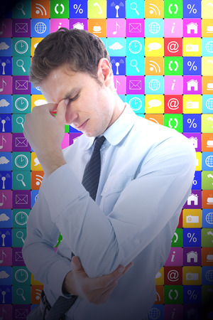 pounding head: Businessman with a headache against app wall