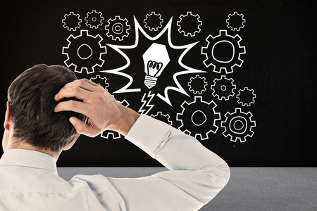 scratching: Businessman scratching his head against black room Stock Photo