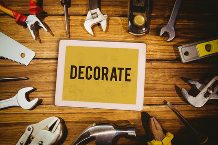 decorate: The word decorate  and tablet pc against architect background