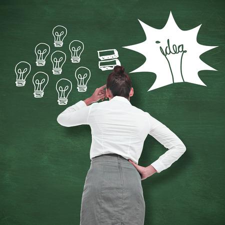 green chalkboard: Businesswoman scratching her head against green chalkboard