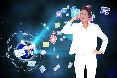 global thinking: Thinking businesswoman against global communication background Stock Photo