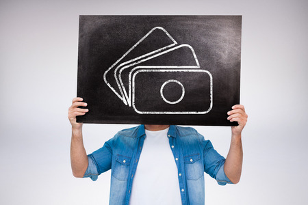 fourties: Casual man showing board against grey background