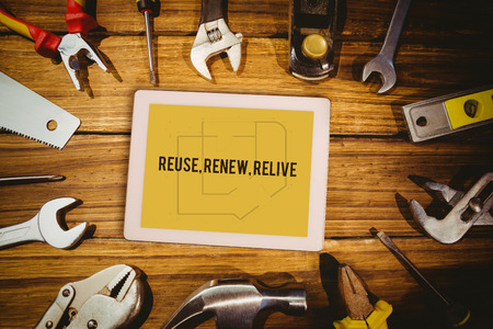 relive: The word reuse, renew, relive and tablet pc against blueprint