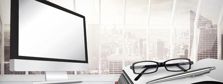 computer screens: Computer screen against window overlooking city