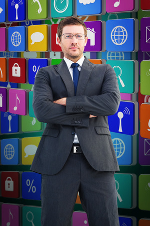 frowning: Frowning businessman looking at camera against green background with vignette