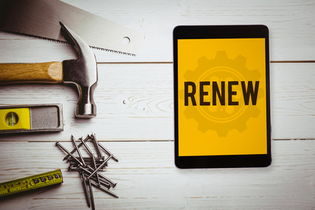 renew: The word renew and tablet pc against blueprint