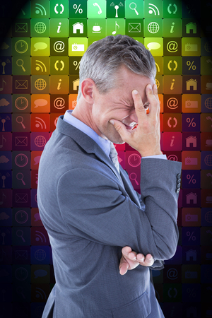pounding head: Businessman with headache against app wall Stock Photo