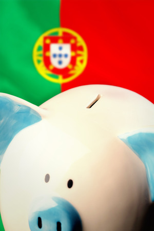 portugese: Piggy bank against digitally generated portugese national flag