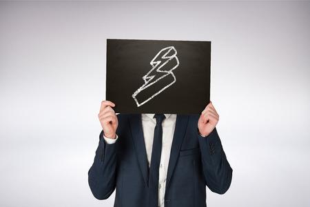 lightning bolt: Businessman holding board against grey background