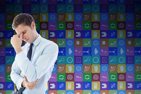 Businessman with a headache against app wall