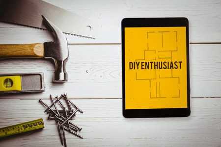 enthusiast: The word diy enthusiast and tablet pc against blueprint