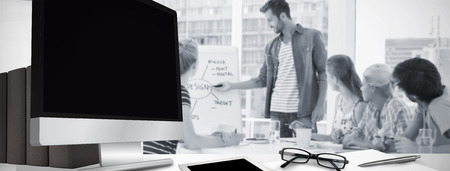 mature business: Computer screen against casual business people in office at presentation