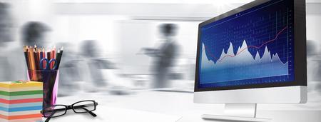 Computer scherm tegen zaken-interface met grafieken en data
