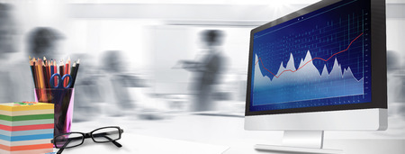 Computer screen against business interface with graphs and data Banco de Imagens