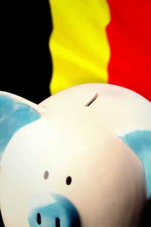 belgium flag: Piggy bank against belgium flag