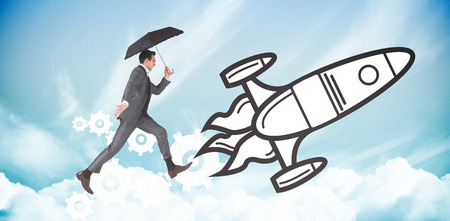 businessman jumping: Businessman jumping holding an umbrella against blue sky Stock Photo