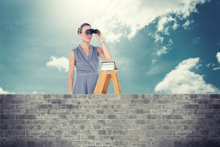 wall covering: Businessman looking on a ladder against brick lined wall covering half sky