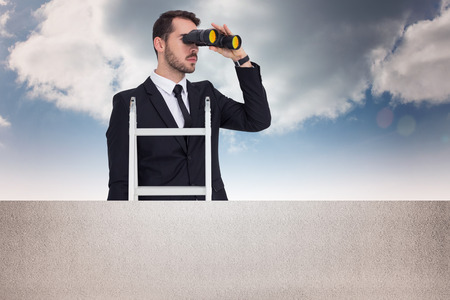 corporate ladder: Businessman looking on a ladder against balcony and bright sky Stock Photo