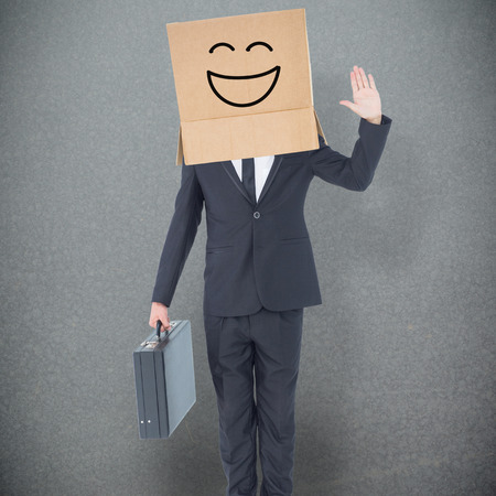 anonymous: Anonymous businessman against grey background Stock Photo