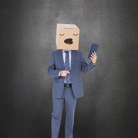 anonymous: Anonymous businessman against grey room Stock Photo