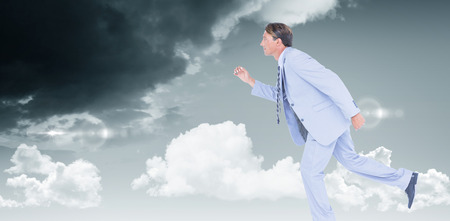 stepping: Stepping businessman against blue sky