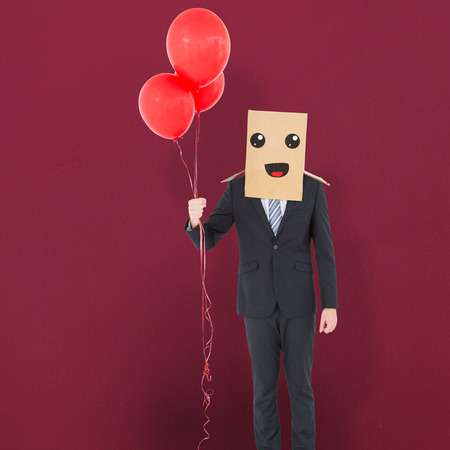 anonymous: Anonymous businessman against red background