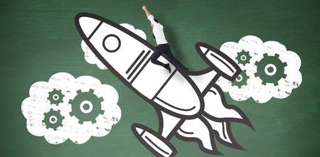 mid adult men: Flying businessman against green chalkboard