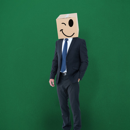 anonymous: Anonymous businessman against green