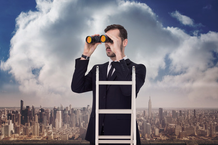 corporate ladder: Businessman looking on a ladder against balcony overlooking city Stock Photo