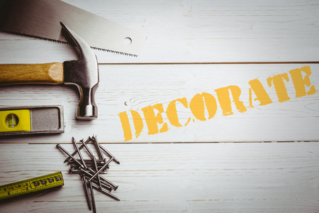 The word decorate  against desk with tools
