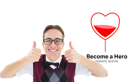 cheesy grin: Smiling geeky hipster looking at camera showing thumbs up against blood donation