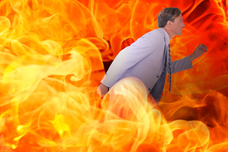stepping: Stepping businessman against fire