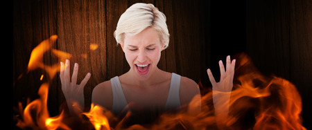 angry blonde: Angry blonde yelling with hands up  against wooden table