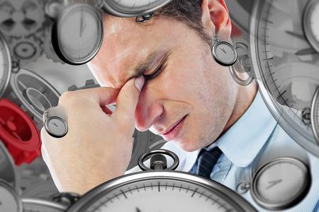 male headache: Businessman with a headache against grey vignette Stock Photo
