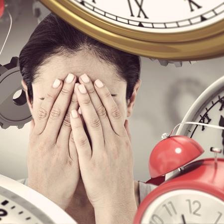 desolaci�n: Sad woman hiding her face against grey vignette