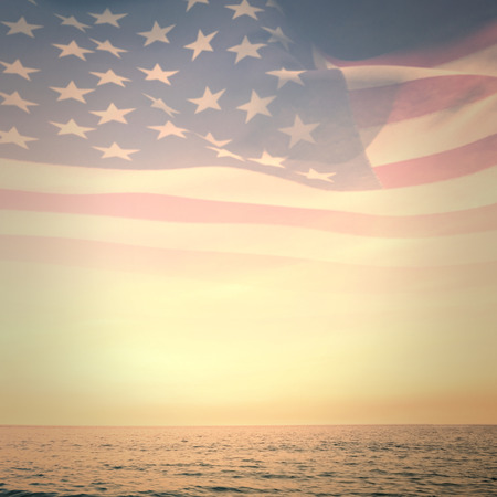 patriotic: Digitally generated american flag rippling against beautiful sunset on a sunny day