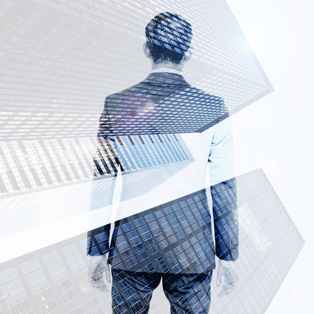 asian businessman: Asian businessman against skyscraper Stock Photo