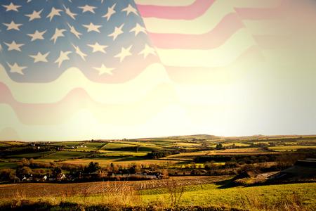 patriotic background: Rippled US flag against scenic landscape