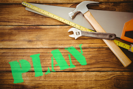 buzzword: The word plan against desk with tools Stock Photo