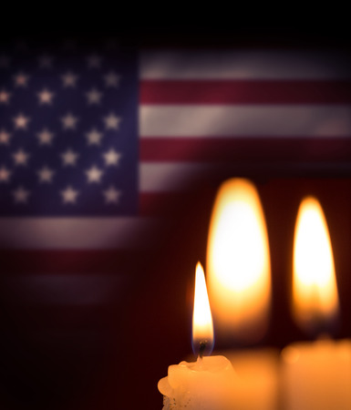 spangled: Candles soft light against digitally generated american national flag
