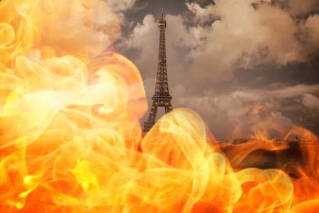 under fire: Fire against paris under cloudy sky