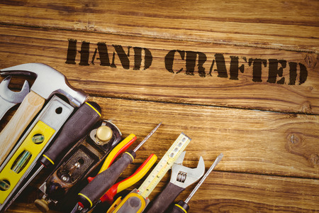 hand crafted: The word hand crafted against tools on desk Stock Photo