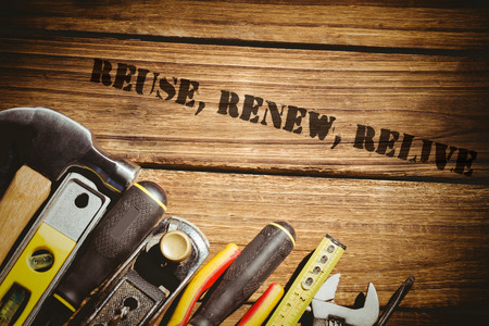 relive: The word reuse, renew, relive against tools on desk