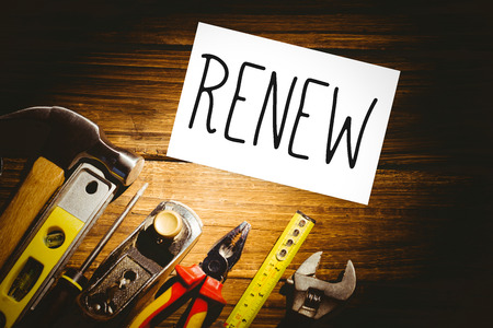 renew: The word renew and white card against desk with tools
