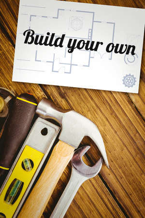 own: The word build your own and blueprint against white card