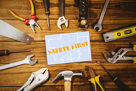 safety first: The word safety first and digital tablet displaying blueprint against white card