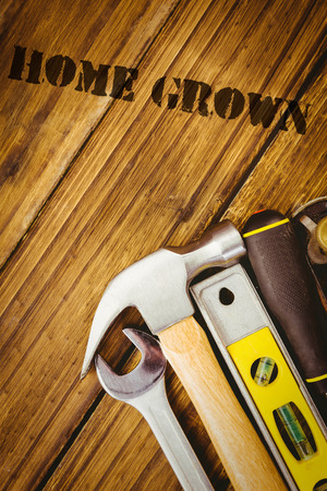 home grown: The word home grown against desk with tools