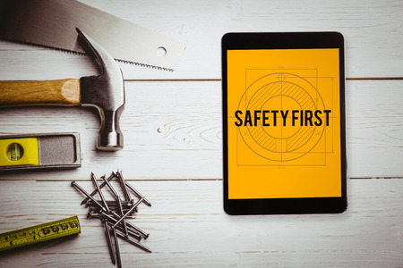 safety first: The word safety first and tablet pc against blueprint