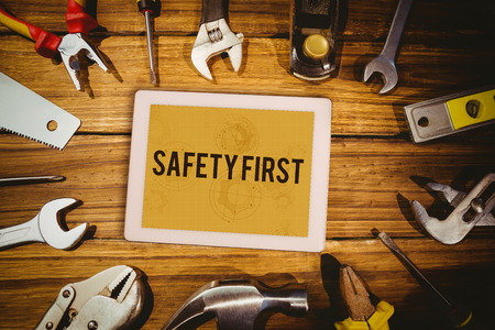 safety first: The word safety first and tablet pc against architect background